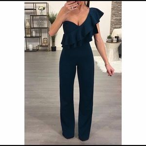 Woman's jumpsuit in teal. Size small